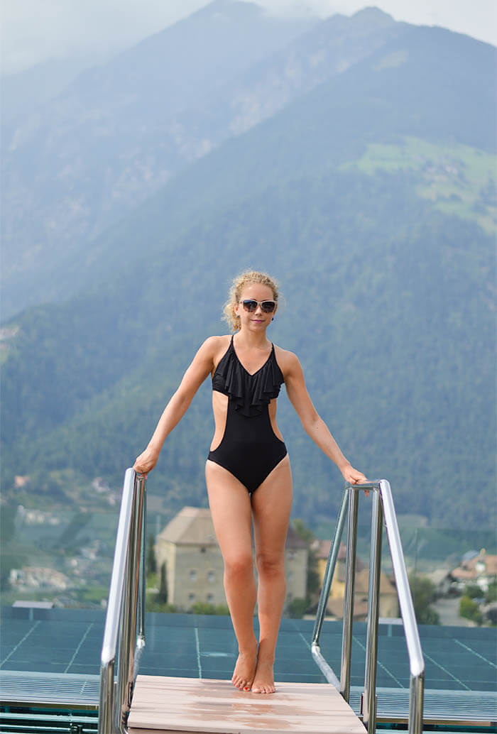 Outfit and Travel: Black Bathing Suit in the Saline-water glass pool of the Vista Spa at Hotel Hohenwart