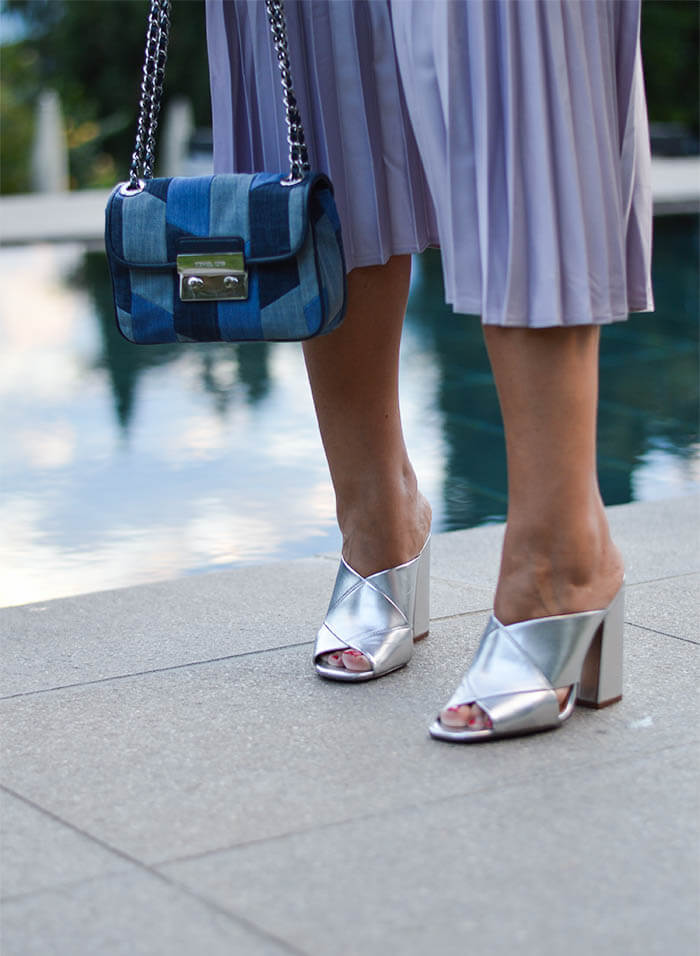 Outfit: Metallic Pleated Skirt, Marble Shirt, Silver Mules and Michael Kors Patchwork Denim