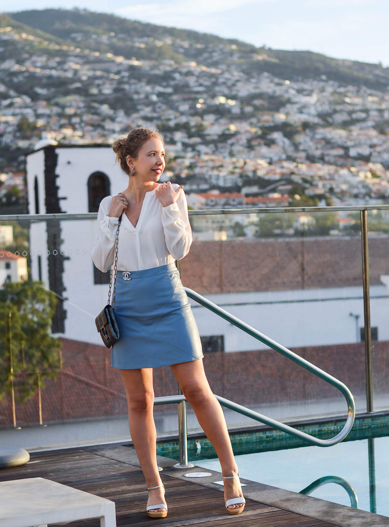 Kationette-fashionblogger-Outfit-White-Blouse-and-Baby-Blue-Leather-Skirt-for-Sunrise-on-a-Rooftop-in-Funchal-Madeira