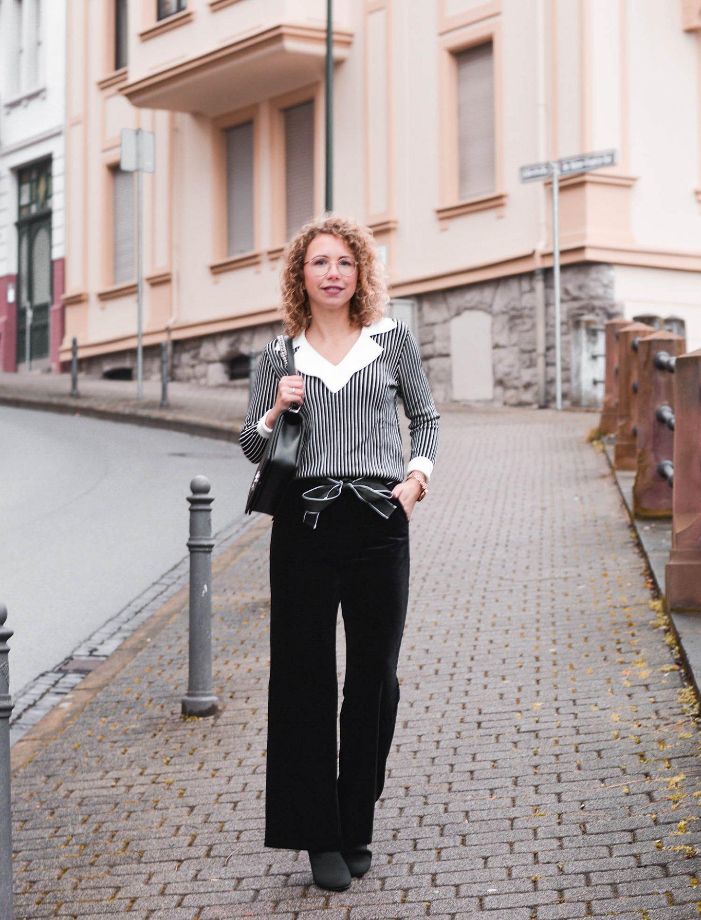 Klassisches Outfit mit Samthose in Schwarz-Weiß